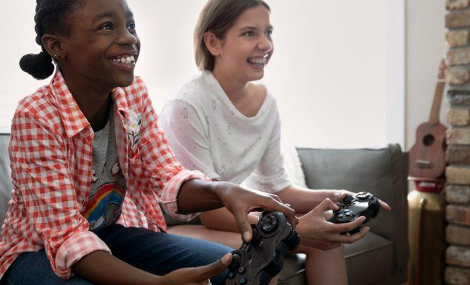 people sitting and enjoying game